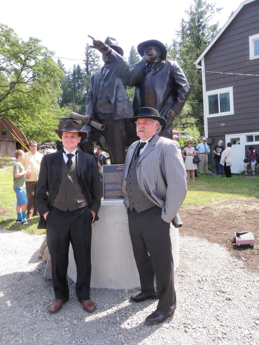 MOdels of Sam Hill and Sam Lancaster pose next to new statue