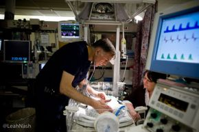Photo of Dr. Patrick Lewallen, Northwest Newborn's medical director, tending to babies in the neonatal ward of Legacy Emanuel Hospital