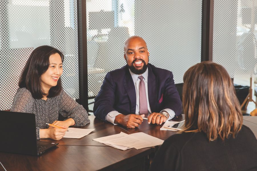 Lane Powell attorneys Dustin O'Quinn and Jessica Yu assist a client.