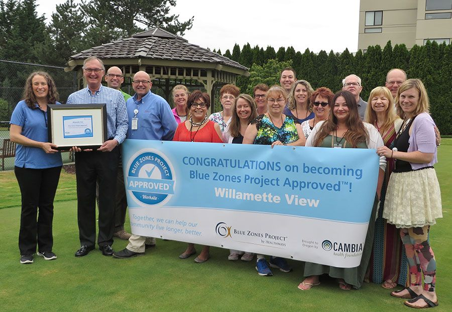 Willamette View staff accepting an award as an approved Blue Zones Project Worksite, a designation that promotes health living for staff and residents