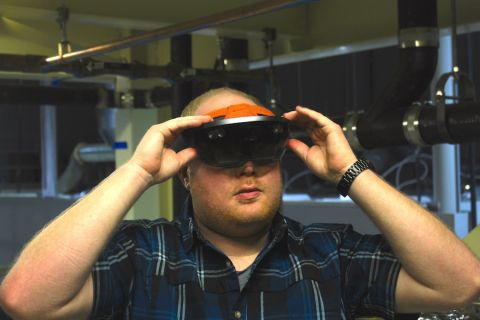 Sean Gustaveson demonstrates the HoloLens, an augmented reality visual aid for plumbers, electricians and engineers.