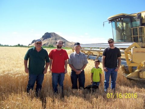 Four of the seven Tuckness generations to farm or ranch in Malheur County.  Left to right with Malheur Butte in the background: Dana , his son Henry, his father Earl, grandson Brody, and son Stanley (Brody's dad).
