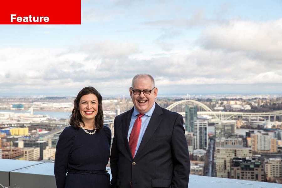 Vanessa Sturgeon and Henry Wessinger, pictured on top of the Park Avenue West building in downtown Portland