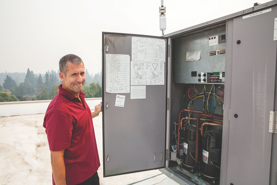 Scott Grice checks on his very efficient, retrofitted RTU controls.